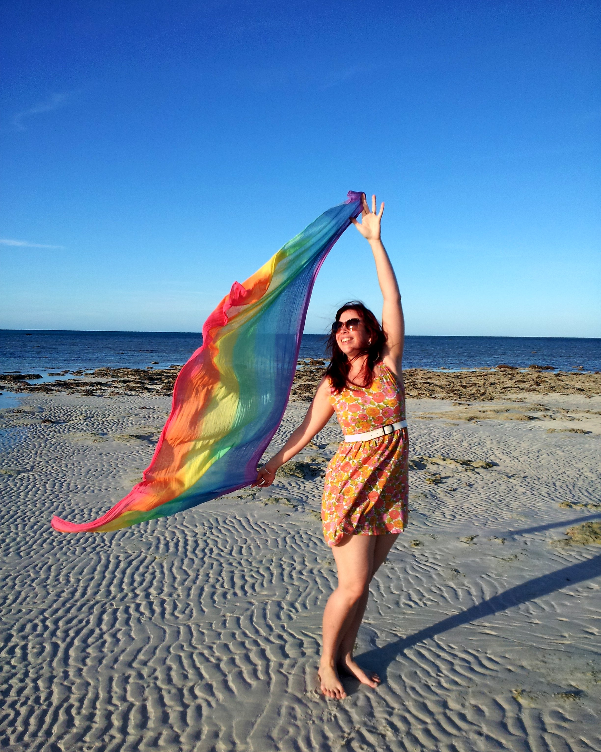 Home Designs North Queensland Holding A Rainbow Scarf On The Sand Quey Epheriell Designs